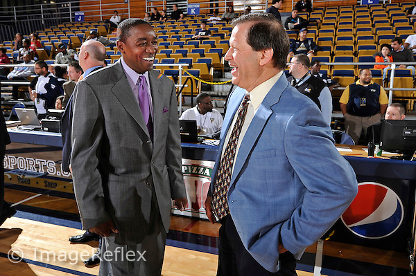 8 January 2011:  FIU Basketball Head Coach Isiah Thomas (left) enjoys a light moment with South Alabama Basketball Head Coach Ronnie Arrow (right) prior to the game.  The FIU Golden Panthers defeated the South Alabama Jaguars, 73-62, at the U.S. Century Bank Arena in Miami, Florida.
