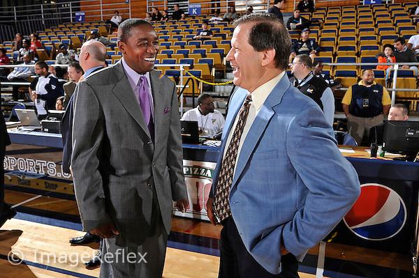 8 January 2011:  FIU Basketball Head Coach Isiah Thomas (left) enjoys a light moment with South Alabama Basketball Head Coach Ronnie Arrow (right) prior to the game.  The FIU Golden Panthers defeated the South Alabama Jaguars, 73-62, at the U.S. Century Bank Arena in Miami, Florida.