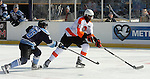 OMAHA, NE - FEBRUARY 9:  Trent Samuels-Thomas #28 from the Omaha Lancers pushes the puck past Jake Wood #26 from the Lincoln Stars in the first period at the Battle on Ice Saturday at TD Ameritrade in Omaha, NE. (Photo by Schyler Eggen/Inertia)