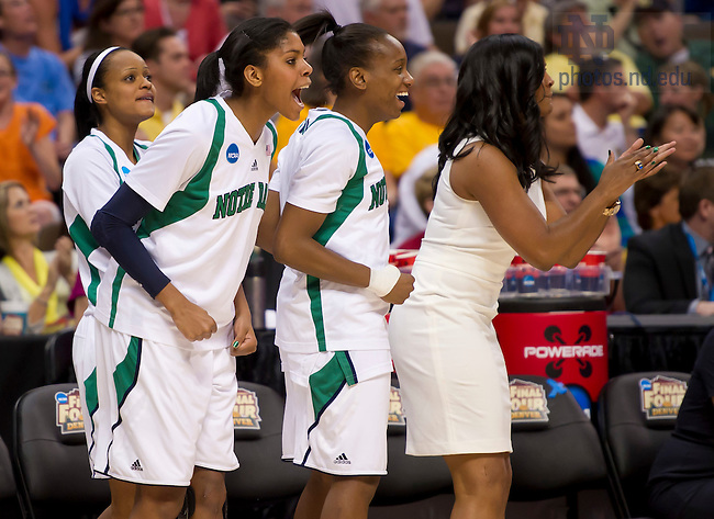 Apr. 1, 2012; The Irish bench celebrates in the closing seconds of Notre Dame's 83-75 win over UConn in the Women's Final Four at the Pepsi Center in Denver, CO...Photo by Matt Cashore/University of Notre Dame