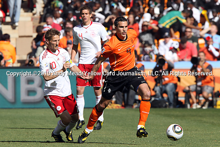 14 JUN 2010:  Robin van Persie (NED)(9) pushes the ball past Martin Jorgensen (DEN)(10).  The Netherlands National Team defeated the Denmark National Team 2-0 at Soccer City Stadium in Johannesburg, South Africa in a 2010 FIFA World Cup Group E match.