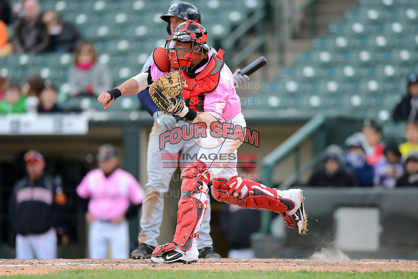 Rochester Red Wings catcher Chris Herrmann #18 throws down to second on a stolen base attempt during a game against the Columbus Clippers on May 12, 2013 at Frontier Field in Rochester, New York.  Rochester defeated Columbus 5-4 wearing special pink jerseys for Mother's Day.  (Mike Janes/Four Seam Images)