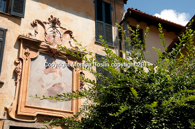 A faded fresco of the Madonna and Child on a house in the Italian town of Castello, a town built on the remains of an old castle on the hills surrounding Lake Lugano