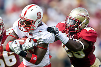October 31, 2009:   North Carolina State wide receiver Darrell Davis (15) tries to break the tackle of Kendall Smith (29) during Atlantic Coast Conference action between the North Carolina State Wolfpack and Florida State Seminoles at Doak Campbell Stadium in Tallahassee, Florida.