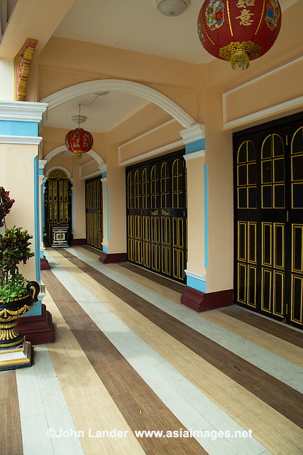 "One of the features of Phuket shophouses  or ""row houses"" is the front verandahs form a sheltered walkway and intricate stucco designs often grace their facades. Many walkways and interiors are covered with ceramic tiles with elaborate European motifs.  Phuket has a long association with European trading nations:  Portugal, Great Britain and France with an established population of ethnic Chinese. Phuket City has always been a meeting place of Thai and Malays and the overall result was a fascinating mixture of architecture - therefore the look and feel of old Phuket is unique in Thailand."