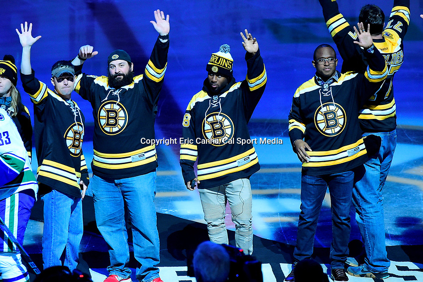 February 11, 2017: New England Patriots assistant coach Josh Boyer, defensive coordinator, running back James White (28) and wide receiver Matthew Slater (18) (L to R) wave to fans before the National Hockey League game between the Vancouver Canucks and the Boston Bruins held at TD Garden, in Boston, Mass. Boston defeats Vancouver 4-3 in regulation time. Eric Canha/CSM
