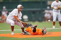 Texas Longhorns shortstop CJ Hinojosa #9 waits for a pickoff throw at second base during the NCAA baseball game against the Oklahoma State Cowboys on April 26, 2014 at UFCU Disch–Falk Field in Austin, Texas. The Cowboys defeated the Longhorns 2-1. (Andrew Woolley/Four Seam Images)