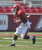 NWA Democrat-Gazette/MICHAEL WOODS • @NWAMICHAELW<br /> University of Arkansas running back Rawleigh Williams III runs drills during practice Saturday, August 15, 2015 at Razorback Stadium in Fayetteville.