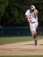 STANFORD, CA - April 12, 2011: Stephen Piscotty of Stanford baseball covers his head as the throw home is high during Stanford's game against Pacific at Sunken Diamond. Stanford won 3-1.