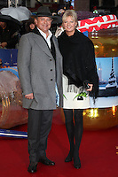 Hugh Bonneville and wife Lulu Evans arriving for the Paddington film premiere, at Odeon Leicester Square, London. 23/11/2014 Picture by: Alexandra Glen / Featureflash