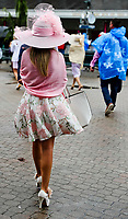 LOUISVILLE, KY - MAY 05: A woman walks in the rain on Kentucky Oaks Day at Churchill Downs on May 5, 2017 in Louisville, Kentucky. (Photo by Jesse Caris/Eclipse Sportswire/Getty Images)