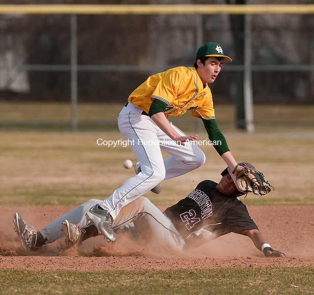 TORRINGTON,  CT,  CT-041315JS12-Torrington's Manny Rijo (24) safely steals second base as the ball skips past Holy Cross' Dylan Pelletier (14) during their game Monday at Fuessenich Park in Torrington. Rijo was able to advance to third base on the play and Torrington went on to win the game 12-8.<br /> Jim Shannon Republican-American