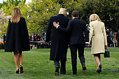 U.S. President Donald Trump with France's president Emmanuel Macron and First Ladies Melania Trump and Brigitte Macron leave after planting a tree, a gift from the President and Mrs. Macron, on the South Lawn of the White House in Washington, D.C., U.S., on Monday, April 23, 2018. As Macron arrives for the first state visit of Trump's presidency, the U.S. leader is threatening to upend the global trading system with tariffs on China, maybe Europe too. <br /> Credit: Yuri Gripas / Pool via CNP