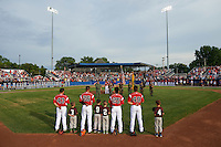 "General view of Batavia Muckdogs Eric Gutierrez (43), Rony Cabrera (26), Samuel Castro (25), and J.J. Gould (49) stand for the national anthem with ""Stars of the Game"" participants as the flag is presented before a game against the Brooklyn Cyclones on July 4, 2016 at Dwyer Stadium in Batavia, New York.  Brooklyn defeated Batavia 5-1.  (Mike Janes/Four Seam Images)"