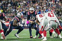 FOXBORO, MA - OCTOBER 10: New England Patriots Quarterback Tom Brady (12) readies to hand off the football as New England Patriots Offensive lineman Shaq Mason (69) moves to block during a game between New York Giants and New England Patriots at Gillettes on October 10, 2019 in Foxboro, Massachusetts.