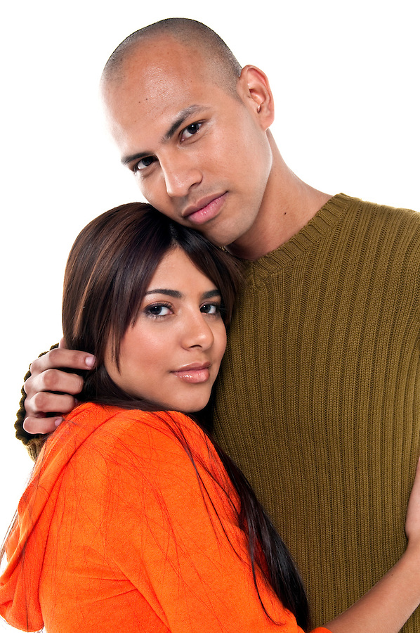 Portrait of lovely trendy multiracial couple, isolated.