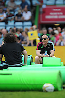 Conor O'Shea, Harlequins Director of Rugby, jokes with Adam Jones before the Aviva Premiership match between Harlequins and Exeter Chiefs at The Twickenham Stoop on Saturday 7th May 2016 (Photo: Rob Munro/Stewart Communications)