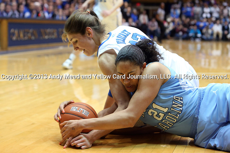 03 March 2013: North Carolina's Krista Gross (21) and Duke's Allison Vernerey (FRA) (43) dive for a loose ball. The Duke University Blue Devils played the University of North Carolina Tar Heels at Cameron Indoor Stadium in Durham, North Carolina in a 2012-2013 NCAA Division I and Atlantic Coast Conference women's college basketball game. Duke won the game 65-58.