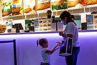 LISBON, PORTUGAL JUNE 15: A person cleans a kid hands with sanitizer inside El Corte Ingles Mall in Lisbon, on June 15, 2020. A delay on the planned reopening of malls in the Lisbon region has been reported after recording new clusters of the coronavirus outbreak. (Photo by Luis Boza/VIEWpress)