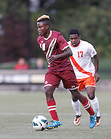 Boston College midfielder Derrick Boateng (10) dribbles.Boston College (maroon) defeated Syracuse University (white/orange), 3-2, at Newton Campus Field, on October 8, 2013.