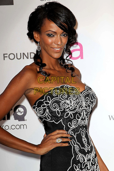 Judi Shekoni.The 21st Annual Elton John AIDS Foundation Academy Awards Viewing Party held at The City of West Hollywood Park in West Hollywood, California, USA..February 24th, 2013.oscars half length black print dress strapless pattern hand on hip  .CAP/ADM/KB.©Kevan Brooks/AdMedia/Capital Pictures. Oscars