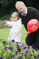 "NO REPRO FEE. World Alzheimer Day launch. 2 year old Ava O Donnell and RTE presenter Micheál O'Muircheartaigh  are pictured in Merrion Square Dublin to discuss a landmark report entitled ""Dementia: It's time for action!"" to mark  World Alzheimer's Day 21 September. Picture James Horan /Collins Photos"