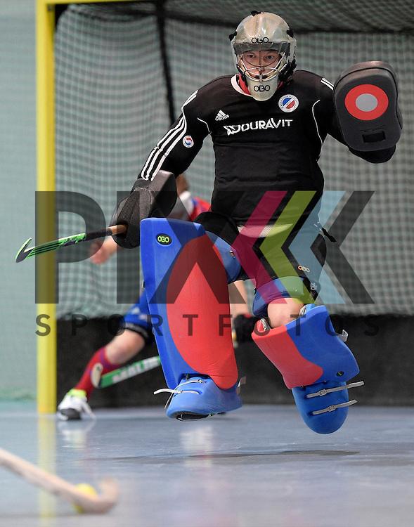 GER - Mannheim, Germany, November 28: During the 1. Bundesliga Sued Herren indoor hockey match between Mannheimer HC (red) and TG Frankenthal (white) on November 28, 2015 at Irma-Roechling-Halle in Mannheim, Germany. Final score 7-7 (HT 3-3).  Lukas Stumpf #4 of Mannheimer HC<br /> <br /> Foto &copy; PIX-Sportfotos *** Foto ist honorarpflichtig! *** Auf Anfrage in hoeherer Qualitaet/Aufloesung. Belegexemplar erbeten. Veroeffentlichung ausschliesslich fuer journalistisch-publizistische Zwecke. For editorial use only.