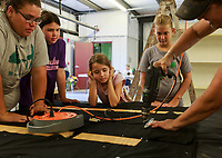 NWA Democrat-Gazette/CHARLIE KAIJO  Shannon Brown of Maysville (right) drills as Tonya Farrister, Kelli McGarrah, 10, Kinzie McGarrah, 7 and Laney Brown, 13, from the Maysville 4-H Club (from left) watch, Saturday, August 4, 2018 at the Benton County Fairgrounds in Bentonville. <br />