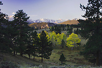 Sunrise over Rocky Mountain Range with Aspen trees in fallcolor, Rocky Mountain National Park, Colorado, USA, September 2006