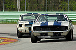 Sam Viviano, in his 1969 Camaro Z-28, leads Curt Vogt in his 1966 Shelby GT350 at the SVRA Vintage GT Challenge at Road America, 2005