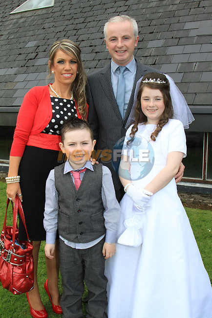 Rhea Hynes, Brother Sean and parents Jacqie and Des..First Communion inn Whitecross Church, Julianstown..Picture Fran Caffrey/Newsfile.ie