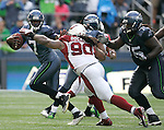 Seattle Seahawks quarterback Tarvaris Jackson scrambles away from  Arizona Cardinals defensive tackle Darnell Dockett at CenturyLink Field in Seattle, Washington September 25, 2011.  The Seahawks beat the Cardinals 13-10.  ©2011 Jim Bryant Photo. All Rights Reserved.