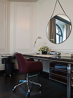 A luxurious desk area occupies a corner of the suite living room