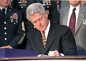 Washington, DC - October 5, 1999 -- U.S. President Bill Clinton signs the $289 Billion Defense Appropriation Bill at a ceremony at the Pentagon on 5 October, 1999.<br /> Credit: Ron Sachs / CNP