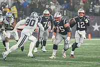 FOXBOROUGH, MA - NOVEMBER 24: New England Patriots Offensive lineman Ted Karras #75 ready to block Dallas Cowboys Defensive End DeMarcus Lawrence #90  as New England Patriots Quarterback Tom Brady #12 prepares to pass during a game between Dallas Cowboys and New England Patriots at Gillettes on November 24, 2019 in Foxborough, Massachusetts.
