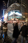 "People on Times Square by night, NYC. A great billboard of the movie ""Flags of our fathers"" (by Clint Eastwood) can be seen."