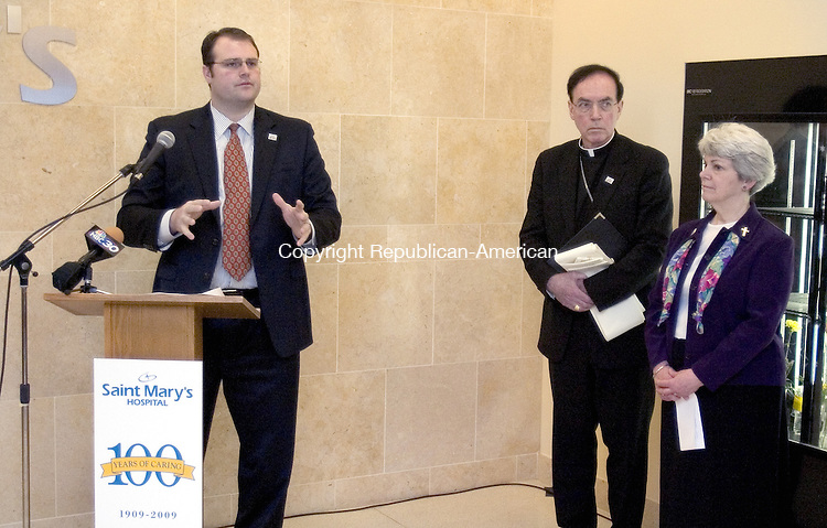 WATERBURY, CT. 12 March 2009-03129SV03--From left, Chad Wable, President and CEO speaks as Arch Bishop Henry J. Mansell, and Sister Dolores Lahr, CSJ, look on during a 100 Anniversary Celebration at Saint Mary&rsquo;s Hospital in Waterbury Thursday.<br /> Steven Valenti Republican-American