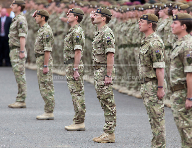 WINDSOR, UK  25/06/11. Officers of the Irish Guards stand to attention in formation in front of their men. The First Battalion, The Irish Guards, recently returned from operation Herric in Afghanistan, were parading at their current base, Victoria Barracks, in Windsor to receive the Afghanistan Campaign Medal from the Duke and Duchess of Cambridge. Photo credit should read Matt Cetti-Roberts