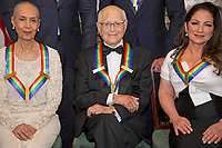 Carmen De Lavallade, left, Norman Lear, center, and Gloria Estefan, right, three of the five recipients of the 40th Annual Kennedy Center Honors, as they pose for a group photo following a dinner hosted by United States Secretary of State Rex Tillerson in their honor at the US Department of State in Washington, D.C. on Saturday, December 2, 2017. The 2017 honorees are: American dancer and choreographer Carmen de Lavallade; Cuban American singer-songwriter and actress Gloria Estefan; American hip hop artist and entertainment icon LL COOL J; American television writer and producer Norman Lear; and American musician and record producer Lionel Richie.  <br /> Credit: Ron Sachs / Pool via CNP /MediaPunch