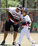 WATERBURY,  CT-071918JS06--Diamond Elite of Cincinnati (OH) head coach Brett Treherne talks with Greyson Treherne (5) after he hit a triple during their Roberto Clemente tournament game against Wolcott Thursday at Municipal Stadium in Waterbury. <br /> Jim Shannon Republican American