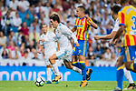 Mateo Kovacic (l) of Real Madrid battles for the ball with Rodrigo Moreno of Valencia CF during their La Liga 2017-18 match between Real Madrid and Valencia CF at the Estadio Santiago Bernabeu on 27 August 2017 in Madrid, Spain. Photo by Diego Gonzalez / Power Sport Images