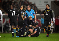 Pictured: Scott Parker of Tottenham Hotspur on the ground is being seen to by team physio. Saturday 31 December 2011<br />