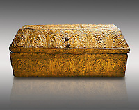 Gothic embossed Brass on wood box, circa 1370-1450, possibly made in Barcelona, Catalunya. National Museum of Catalan Art, Barcelona, Spain, inv no: MNAC 5361. Against a light grey background.
