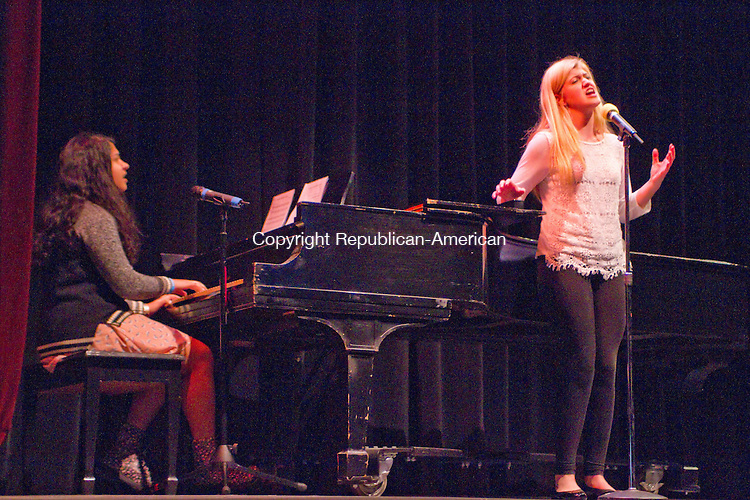 WATERTOWN, CT20 January 2014-012014LW01 - Andria Benvenuto of Watertown sings &quot;People Help the People&quot; by Birdy, accompianied by Srinidhi Bharadwaj of Virginia on piano during Taft School's Martin Luther King Day celebration Monday in Watertown.<br /> Laraine Weschler Republican-American