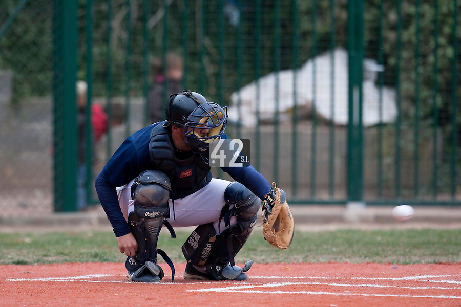 03 october 2009: Vincent Ferreira of Savigny is seen catching during game 1 of the 2009 French Elite Finals won 6-5 by Rouen over Savigny in the 11th inning, at Stade Pierre Rolland stadium in Rouen, France.