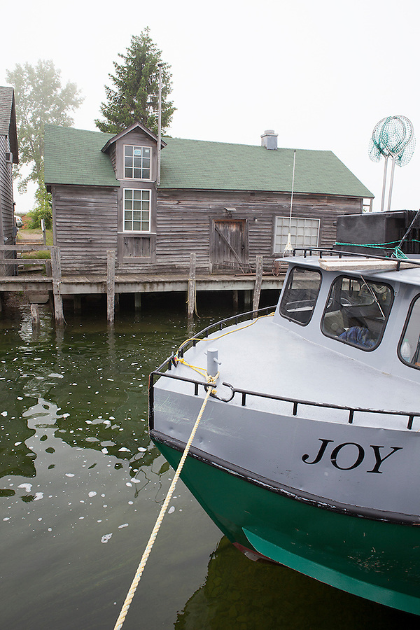 A boat named JOY on the canal in the Leland Historic District (Fishtown), Michigan, MI, USA
