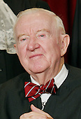 United States Supreme Court Associate Justice John Paul Stevens poses during a group portrait session with the members of the United States Supreme Court , at the Supreme Court Building in Washington,  DC on December 5, 2003.  Former United States President Gerald R. Ford nominated Stevens to the Supreme Court. Stevens took his seat on December 19, 1975.