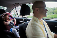 Fred Bermont drives his children Elyse Bermont (age 2.5, rear) and Dylan Bermont (age 9 months, not pictured) to day-care in Lexington, Massachusetts, USA, before he goes to work on June 9, 2014. Bermont is the father of two children and shares parenting duties with his wife, Jen Bermont. Fred usually takes care of the morning routine, including feeding, dressing, and dropping the kids off at day-care, and Jen picks them up and watches over them in the afternoon. Fred is a Senior Clinical Standards Specialist at Shire, a pharmaceutical company with headquarters in Lexington.