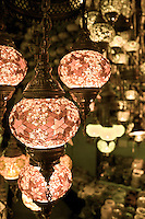 "Traditional mosaic lighting fixtures used among a wide range of Arab countries, know for ""Fawanees"" for plural and ""Fanoos"" for singular.  They are made of metal and colorful glass.  These particular ones are found in The Grand Bazar, Istanbul, Turkey."
