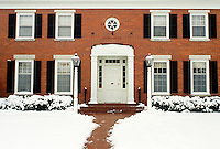 Red Brick Georgian house in snow, january, Midwest USA